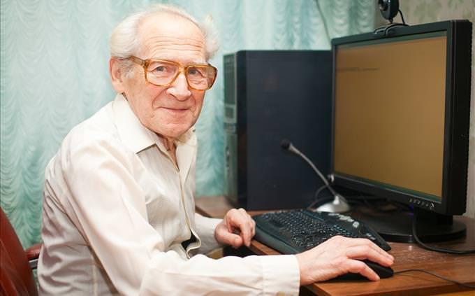 elderly man using PC